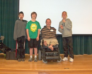 Smiling Students with Inspirational Speaker, Chet McDoniel