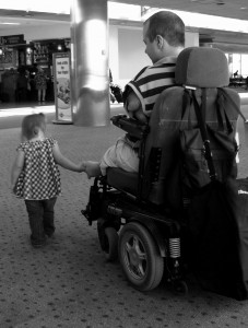 Inspirational Speaker - Chet McDoniel walks hand-in-hand with his daughter.