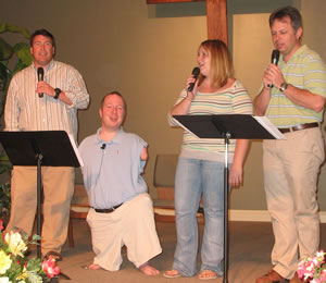 Chet leading worship with (from left to right) Ben Wall, Jessica McDoniel and Randy McDoniel